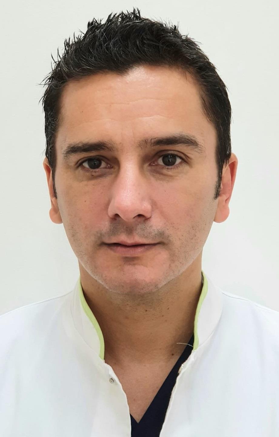 Dr. Costin Gabriel Mitroi