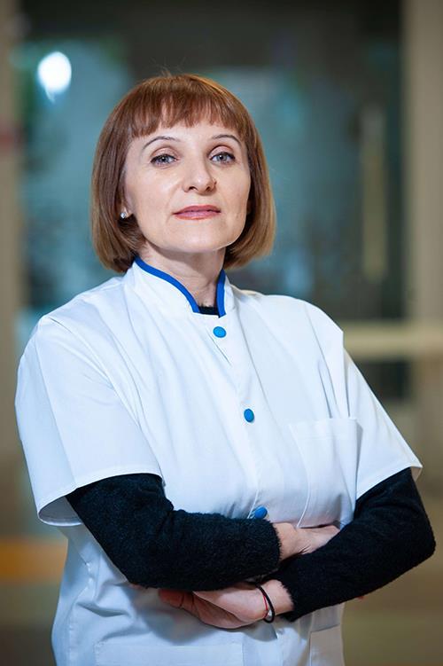 Dr. Veronica  Staicu