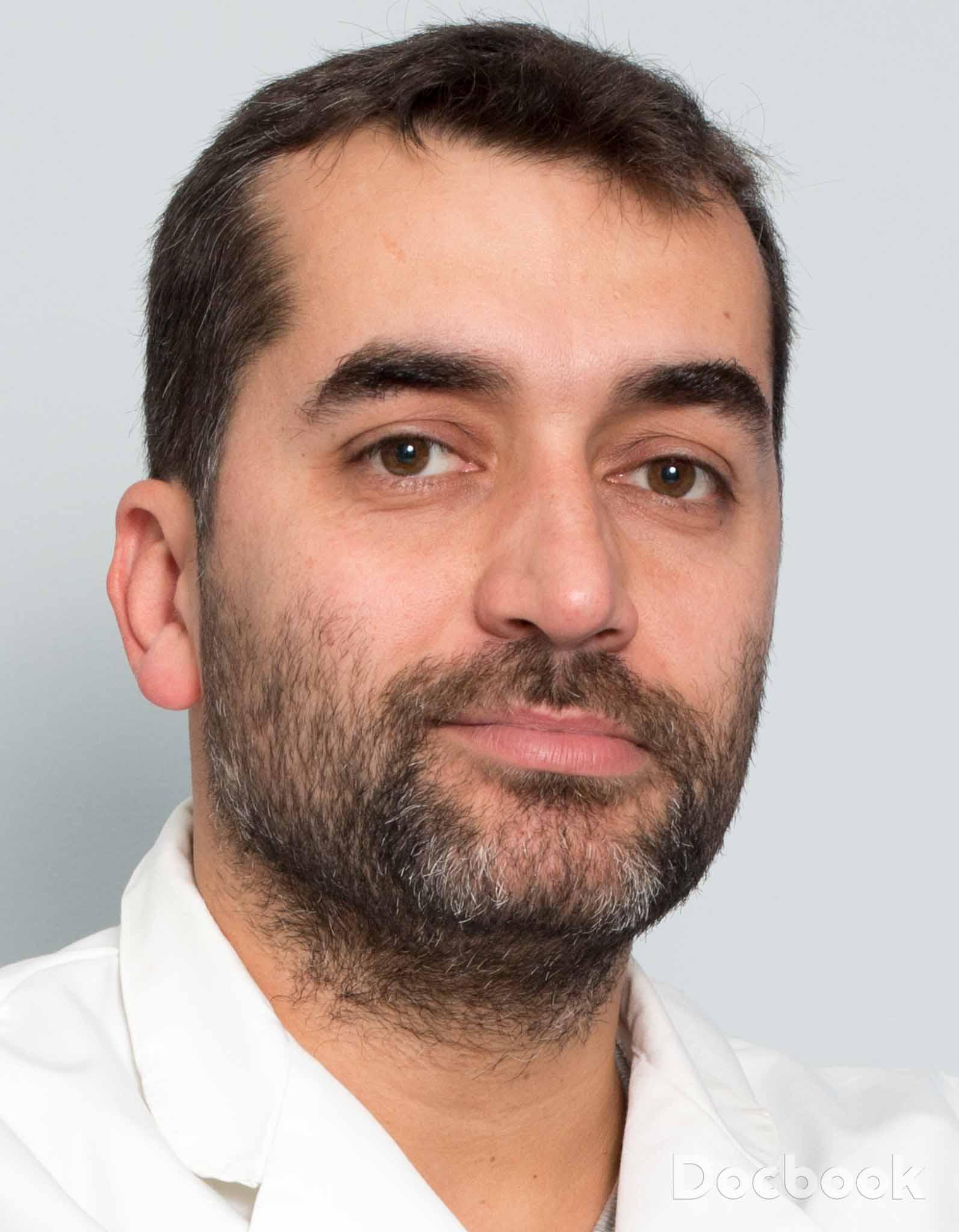 Dr. Marius Romila